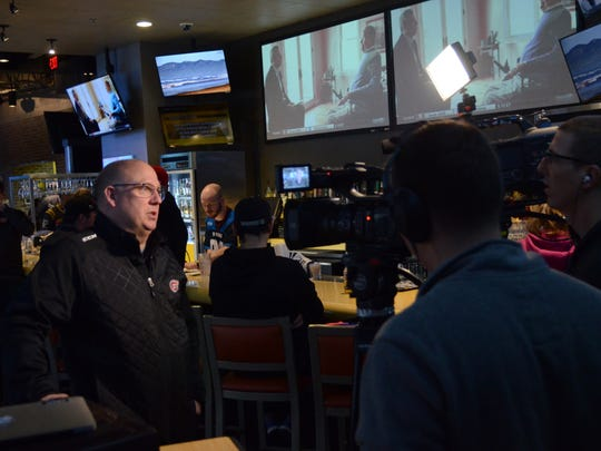 St. Cloud State head coach Bob Motzko is interviewed by a TV station after his team was named the No. 1 overall seed for the NCAA Division I men's hockey tournament. The Huskies play Air Force at 3 p.m. Friday in Sioux Falls, South Dakota.