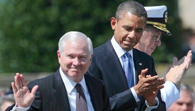 Former Defense secretary Robert Gates is seen with President Obama.