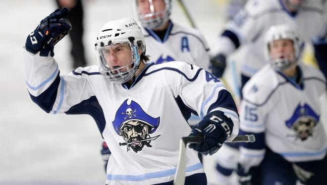 Bay Port's Max Moore (4) celebrates after scoring against Notre Dame in a WIAA boys hockey regional final at Cornerstone Community Center on Thursday, February 15, 2018 in De Pere, Wis.