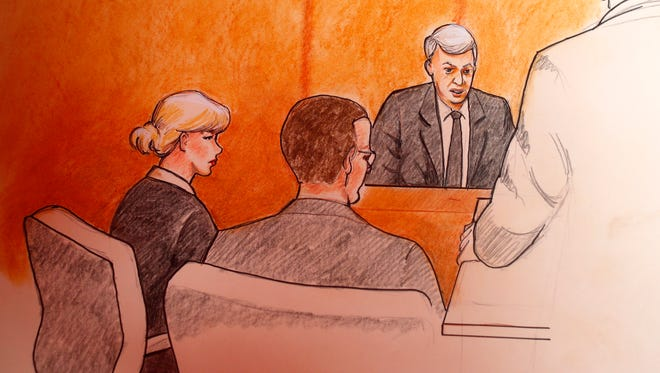 In this sketch by courtroom artist Jeff Kandyba, Taylor Swift and her lawyer look on as ex-DJ David Mueller testifies in their civil trial in federal court in Denver.