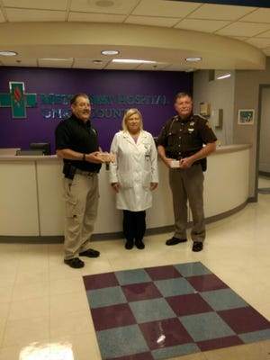 Peggy Creighton of Methodist Hospital presented these 30 doses to Union County Sheriff Mickey Arnold and Chief Jeffery Hart of Uniontown PD.