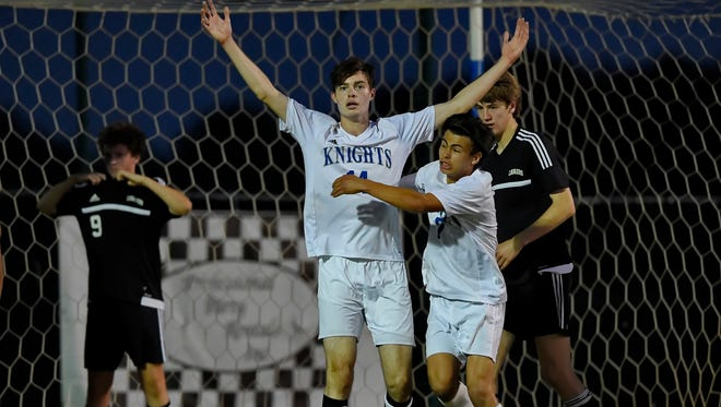 Alfredo Diaz-Santillan, right, celebrates with teammate Brandon Vogt after Vogt scored in the closing seconds to give St. Joseph's a 4-3 win over visiting Christ Church in the Class AA Upper State championship match Tuesday night