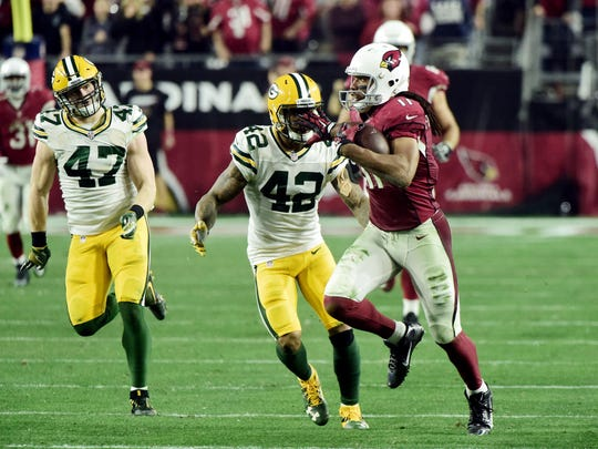 Jan 16, 2016; Glendale, AZ, USA; Arizona Cardinals wide receiver Larry Fitzgerald (11) runs with the ball in overtime against the Green Bay Packers in a NFC Divisional round playoff game at University of Phoenix Stadium. Mandatory Credit: Matt Kartozian-USA TODAY Sports