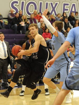 USF's #44 Jordan Stotts  drives to the basket against Upper Iowa's #10 Jimmy Roth during basketball action at the Stewart Center in Sioux Falls, S.D., Saturday, Jan. 9, 2016.