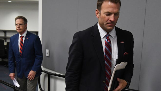 Ross Bjork, right, has yet to make a hire for a men's basketball, baseball or football head coaching vacancy at Ole Miss.