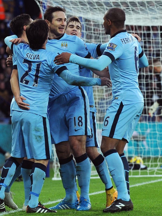 Manchester City's Frank Lampard, middle, celebrates with team mates after scoring against Leicester during the English Premier League soccer match between Leicester City and Manchester City at King Power Stadium, in Leicester, England, Saturday, Dec. 13, 2014.  (AP Photo/Rui Vieira)