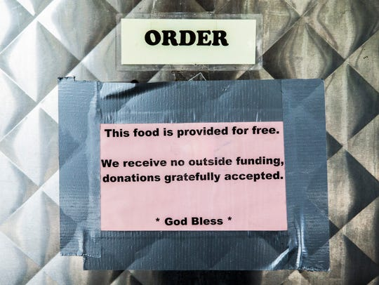 A sign lets customers know that their meals are free