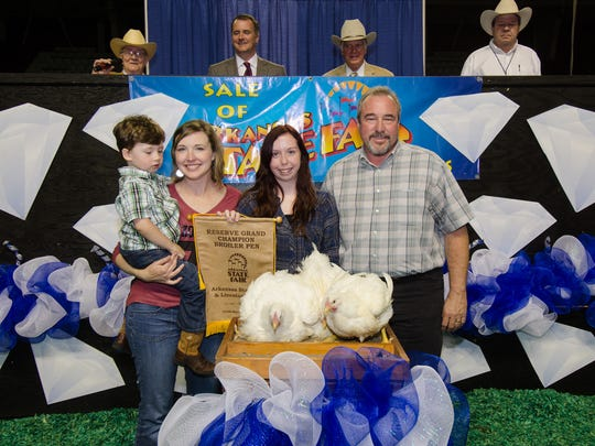 Mountain Home High School senior Chelsea Donaldson (second from right) is shown with (from left) Leslie Jo Tucker and her 3-year-old son, Jack, and Wayne Freeman, of Hot Springs, representing the University of Arkansas, Division of Agriculture.