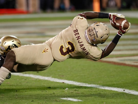 Arizona State running back Eno Benjamin lunges for