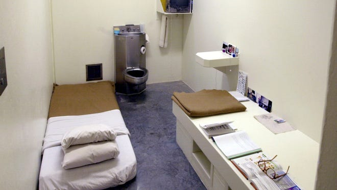 The interior of a solitary cell at the Wisconsin Secure Program Facility in Boscobel, seen during a media tour in 2001. Inmates may place the mattress on the floor which in turn creates a desk-like area for studies.