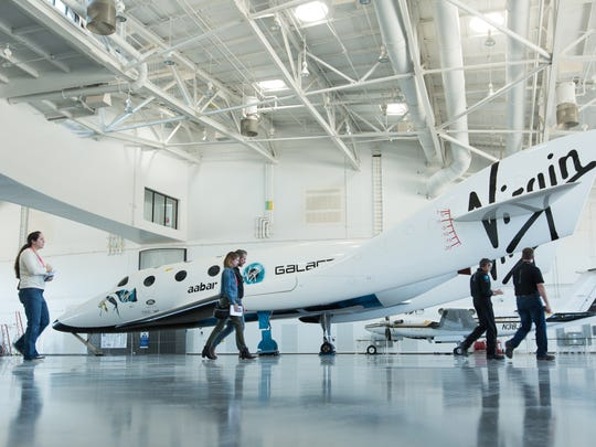 A full-sized model of the SpaceShipTwo is displayed