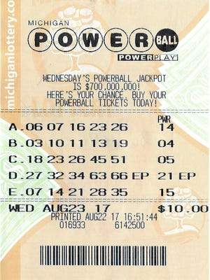 This Powerball ticket worth $1 million was turned in to Michigan Lottery headquarters in Lansing on Sept.  12, 2017. Sixteen members of a Livingston County lottery club will split the prize.