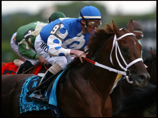 Stewart Elliott, aboard (#9, blue & white) Smarty Jones, takes off from the gate during the 136th Running of The Belmont in Elmont, NY Saturday June 5, 2004.