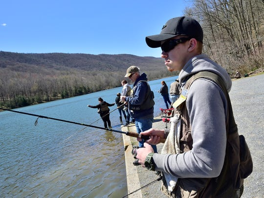 Shane Nenninger, Shippensburg, casts his fishing line