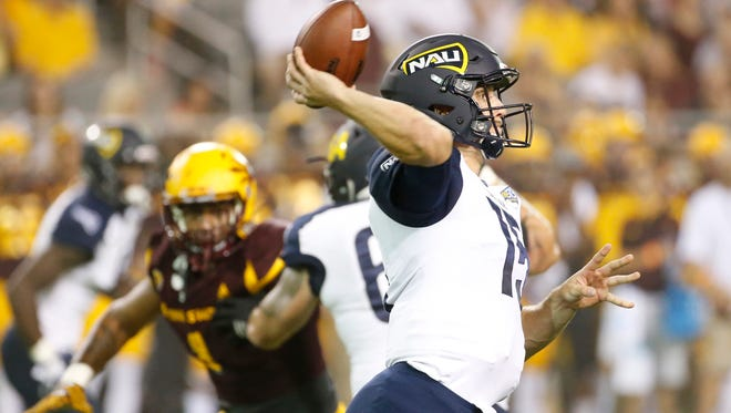 Northern Arizona quarterback Case Cookus passes the ball in a 2016 game against Arizona State at Sun Devil Stadium in Tempe on Sept. 3, 2016.