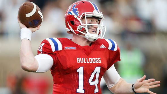 Louisiana Tech's Ryan Higgins (14) drops back to pass