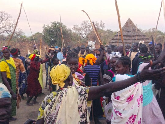 Villagers in Kalthok, South Sudan, dress in traditional clothing in January to celebrate the return of Peter Keny. Keny, who lives in Burlington, had not gone back to Kalthok since he fled civil war there in 1989, when he was six years old.