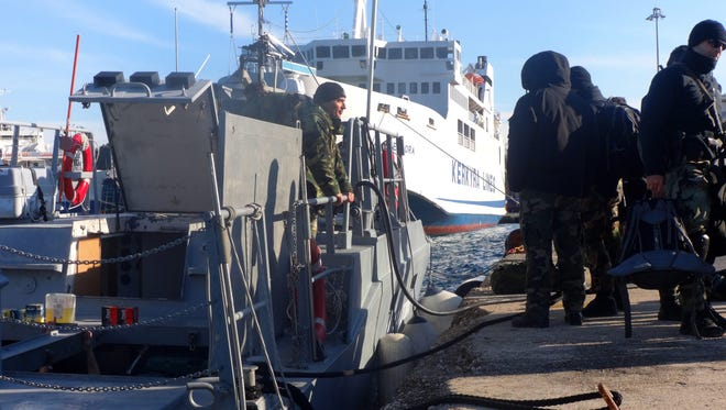 Armed special missions officers of the Greek coast guard set off from Corfu harbor for waters off the Ionian island of Othoni, responding to a distress signal from Moldovan-registered freighter 'Blue Sky M' in the area Dec. 30, 2014.