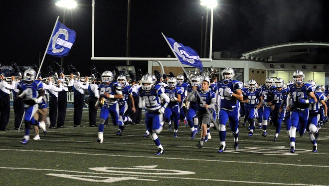 The Cavemen football team takes the field for Friday's Homecoming game.