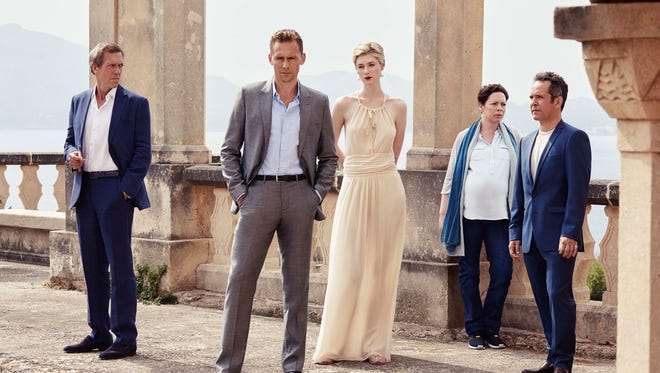 Tom Hiddleston, foreground left, heads the cast of the AMC miniseries, 'The Night Manager.'