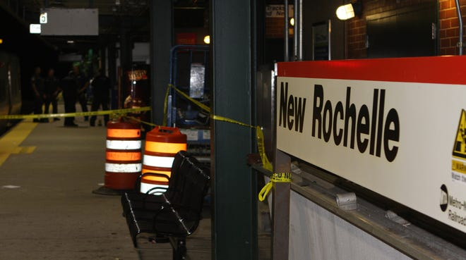 New Rochelle and MTA police officers investigate a man's death on the Metro-North train tracks in New Rochelle on Monday, July 21, 2014.
