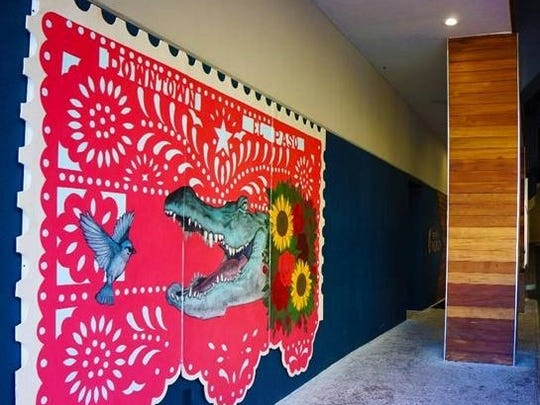"""El Paso muralist Dave """"Grave"""" Herrera recently completed a mural in the parking garage entrance at Hotel Indigo in Downtown El Paso."""