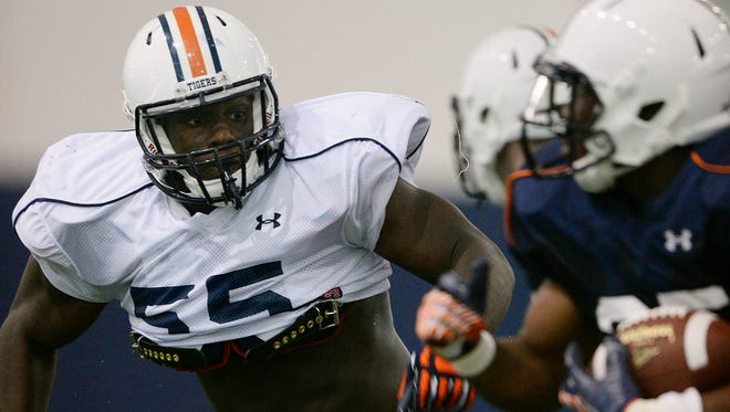 Carl Lawson returned to the practice field this week.