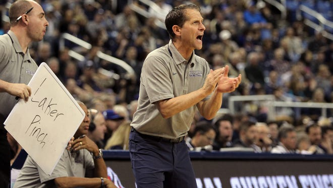 Nevada coach Eric Musselman cheers on his players during a Jan. 13 win over Utah State at Lawlor Events Center in Reno, Nev.