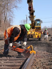 Metro-North Railroad workers replace track along the Harlem Line just north of the Brewster Train Station April 21, 2018.