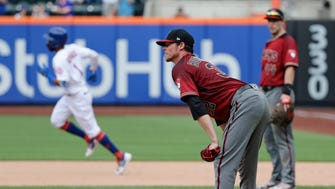 Arizona Diamondbacks starting pitcher Clay Buchholz reacts as New York Mets' Amed Rosario runs the bases after hitting a home run during the sixth inning of a baseball game Sunday, May 20, 2018, in New York.
