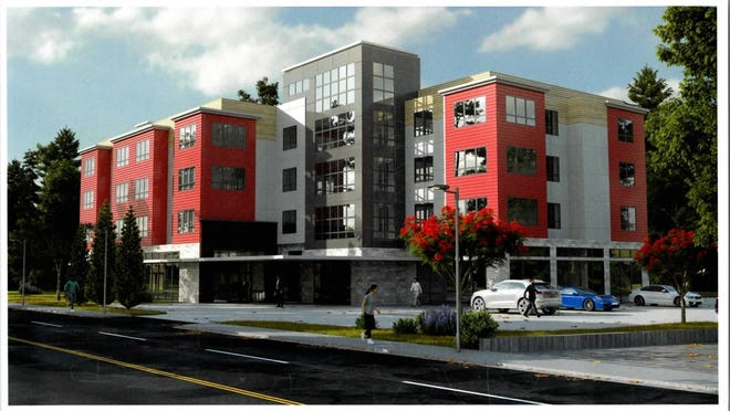 A new three-and-a-half story apartment and retail complex will be constructed on the site of the former Colonial Bowl on Route 18.   [Courtesy Sketch provided by CMK Development Partners)