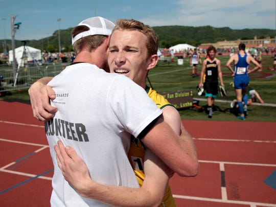 FOR APPLETON: Sam Hinz of Freedom hugs his brother