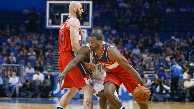 Washington Wizards center Marcin Gortat sets a pick against Orlando to free up Wizards guard John Wall in 2016.