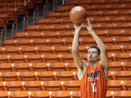 UTEP junior forward Jake Flaggert shoots a 3 pointer during the team's first practice of the season. He broke his nose during the Sun Bowl tournament.