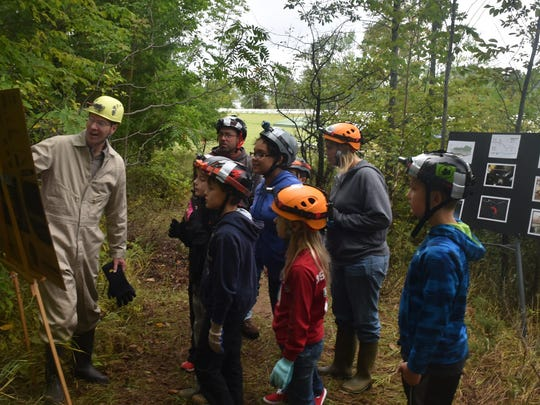 St. Peters Lutheran School students learn about Horseshoe Bay Cave from Door County Parks Director Erik Aleson on Friday before entering at its entrance south of Egg Harbor.