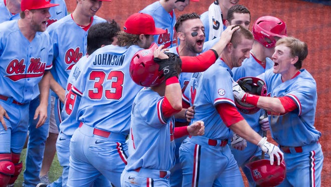 Center fielder J.B. Woodman is mobbed by teammates after hitting his second two-run home run Saturday afternoon against LSU. Ole Miss earned an 8-2 win to take the series.
