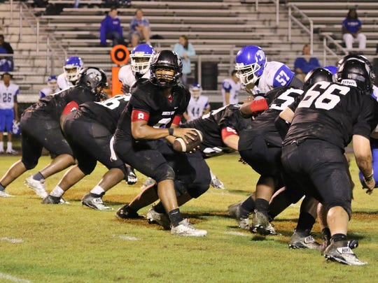South Side's Ricky Beard looks to hand off the ball against Fayette-Ware on Friday.