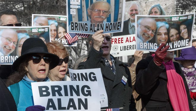 Supporters rally on behalf of U.S. citizen Alan Gross, who had been held prisoner in Cuba for five years. He was released Wednesday.