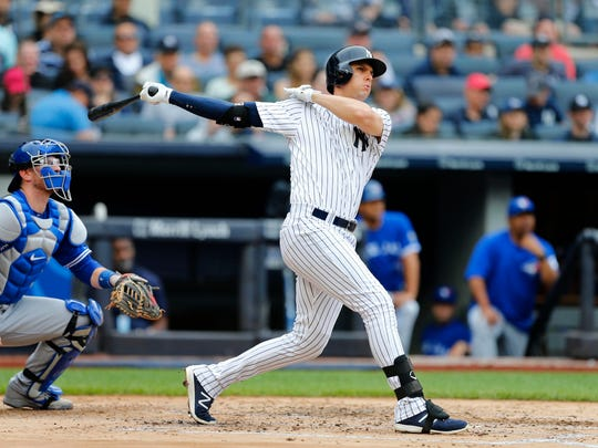 New York Yankees' Greg Bird (33) follows through on a grand slam in the first inning of a baseball game against the Toronto Blue Jays, Sunday, Aug. 19, 2018 in New York. (AP Photo/Noah K. Murray)