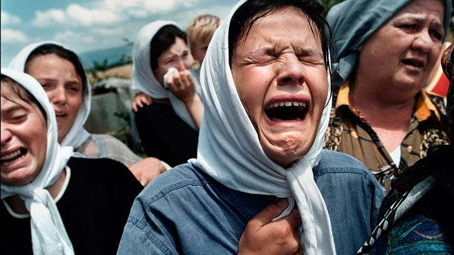Teuta Hajdari wails in grief after the burial of her uncle, whose body was found with his daughter's  in a grave of nine bodies in the village of Bukosh. Carol Guzy's coverage of the crisis in Kosovo was awarded a Pulitzer Prize in feature photography in 2000. Guzy will receive the 2020 FOTOmentor during FOTOfusion, which will be held Feb. 11-15 in West Palm Beach.