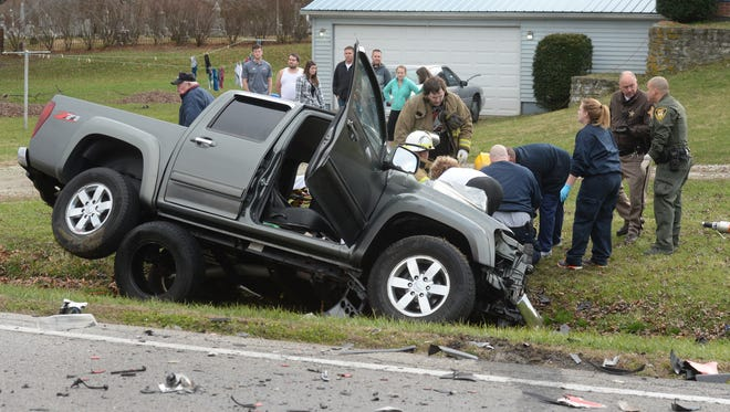 First responders react after an accident between a pickup and a semi tractor-trailer Wednesday, Dec. 16, 2015, on U.S. 35 north of Centerville Road and Williamsburg.