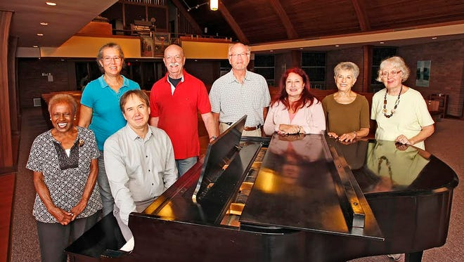 A group of Montclair residents who are longstanding members of the Oratorio Society of New Jersey, with conductor Sandor Szabo, at the First Lutheran Church in Montclair, where OSNJ rehearses. Szabo is at the piano; from left are Ernestine Galloway, Robyn Burns, Don Moore, Don Foster, Cia Siebert, OSNJ President Susan Ladov and Mary Stein.