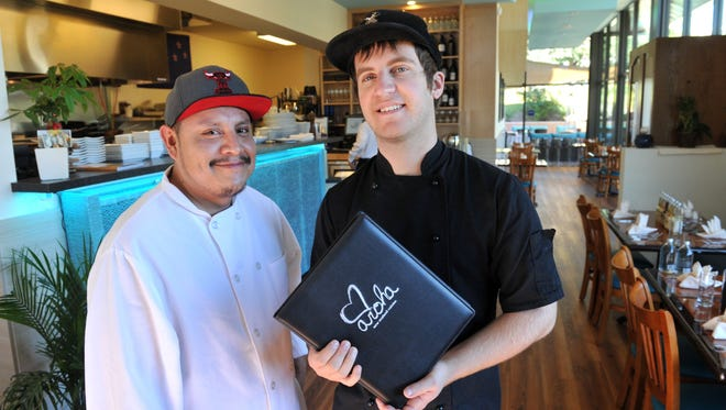 Aroha New Zealand Cuisine owner and executive chef Gwithyen Thomas, right, and sous chef Noe Lopez pose in the dining room of the Westlake Village restaurant in this 2014 photo.