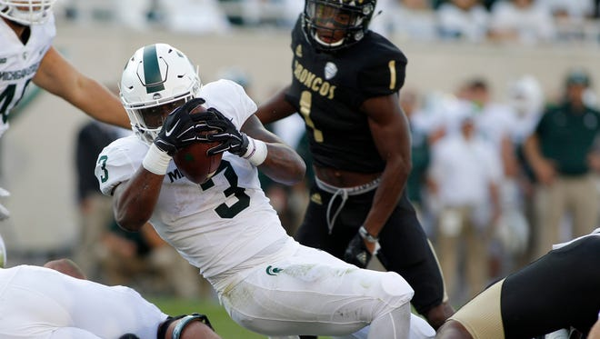 Michigan State running back LJ Scott stretches over the goal line for a touchdown against Western Michigan in the fourth quarter Saturday, Sept. 9, 2017 in East Lansing.