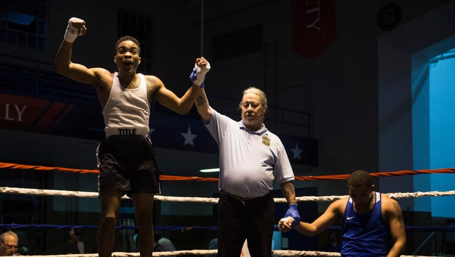Raymon Henry, left, jumps in celebration after being announced the winner over Karon Spivey, right, during the Indiana State Golden Gloves regional semi-championship   at the Tyndall Armory in Indianapolis on Thursday, April 12, 2018.