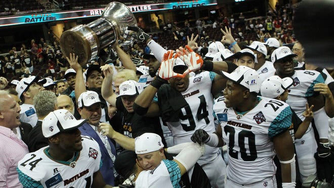 Members of the Arizona Rattlers celebrate after they defeated the Cleveland Gladiators Saturday, August 23, 2014.