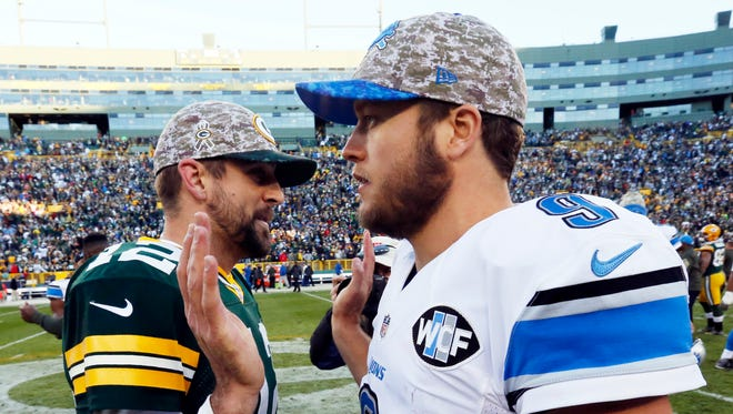 In this Nov. 15, 2015 photo, Packers quarterback Aaron Rodgers talks to Lions quarterback Matthew Stafford after a game in Green Bay, Wis.