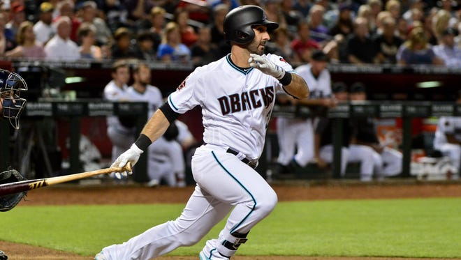 May 15, 2018: Arizona Diamondbacks third baseman Daniel Descalso (3) hits an RBI single in the eighth inning against the Milwaukee Brewers at Chase Field.