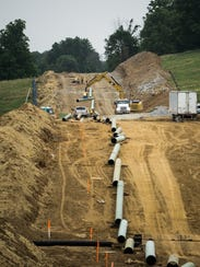 Crews place pipe for the Sunoco Mariner East pipeline