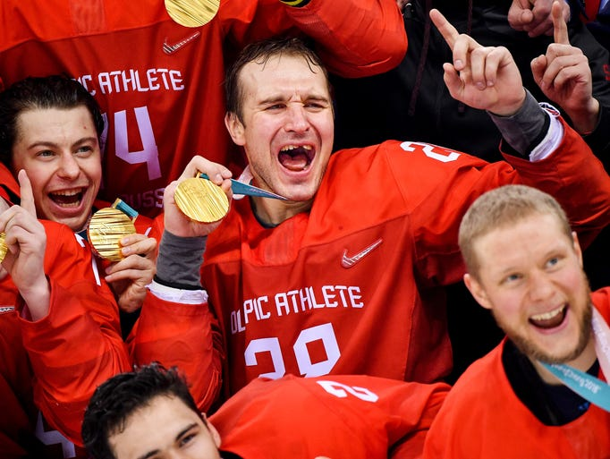 Russia defenseman Andrei Zubarev (28) celebrates after